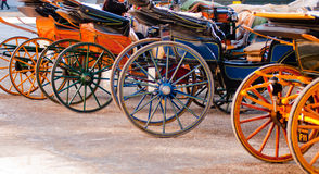 Salzburg horse carriage wheels. Horse carriage wheels of varied colors in Salzburg, Austria Royalty Free Stock Photo