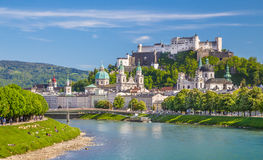 Salzburg skyline with Festung Hohensalzburg and Salzach river in summer. Beautiful view of Salzburg skyline with Festung Hohensalzburg and Salzach river in Royalty Free Stock Photo
