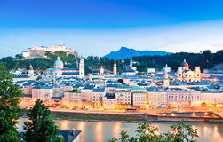 Salzburg skyline with river Salzach at dusk, Salzburger Land, Austria Stock Images