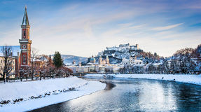 Salzburg skyline with river Salzach in winter, Austria. Panoramic view of Salzburg skyline with Festung Hohensalzburg and river Salzach in winter, Salzburger Royalty Free Stock Photography