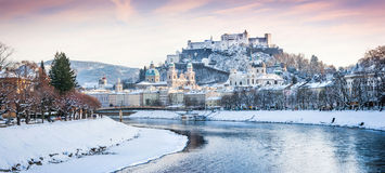 Salzburg skyline with river Salzach in winter, Salzburger Land, Austria. Panoramic view of Salzburg skyline with Festung Hohensalzburg and river Salzach in Royalty Free Stock Photo
