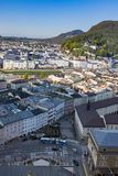Salzburg Village Rooftops on Hills Background Stock Images