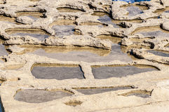 Salzpfannen nahe Qbajjar in Gozo, Malta Lizenzfreie Stockfotos