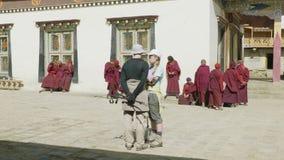 SAMAGAON, NEPAL - MARCH, 2018: Tourists watch local Buddhist monk near monastery. stock video