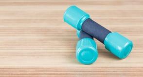 Samall Fitness dumbbells on the desk wooden. Fitness dumbbells on the desk wooden stock photos