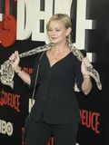 Samantha Mathis. Looks like actress Samantha Mathis is about to unveil a shimmy move with her stylish scarf as she arrives for the New York premiere of HBO`s Royalty Free Stock Photography
