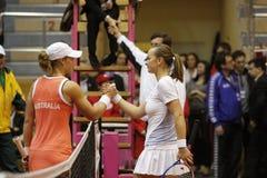 Samantha Stosur- Mariya Koryttseva. KHARKIV, UKRAINE - APRIL 24: Ukrainian tennis player Mariya Koryttseva (R) shake hand her opponent at Fed Cup, 2010 World Stock Photography