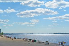 Samara, city beach on the shores of the Volga River. beautiful cumulus clouds. Samara, people on city beach on the shores of the Volga River. beautiful cumulus stock photo