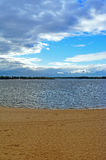 Samara, city beach on the shores of the Volga River at cloudy autumn day. Beautiful cumulus clouds Stock Images
