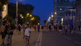 Football fans at the official FIFA FAN FEST zone. SAMARA - JUNE 25, 2018: Football fans waving hands and flags, dancing before the game Uruguay - Russia at the stock video
