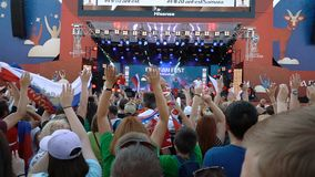 Football fans at the official Fifa Fan Fest zone. Samara - June 25, 2018: Slow motion - football fans waving hands and flags, before the game Uruguay - Russia at stock video