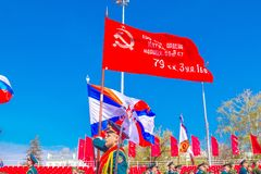 Samara, May 2018: Servicemen of the guard of honor carry the banner of Victory and the Russian tricolor at the ceremonial march of. Russia, Samara, May 2018 royalty free stock image