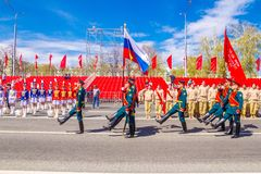 Samara, May 2018: Servicemen of the guard of honor carry the banner of Victory and the Russian tricolor at the ceremonial march of. Russia, Samara, May 2018 stock photos