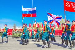 Samara, May 2018: Servicemen of the guard of honor carry the banner of Victory and the Russian tricolor at the ceremonial march of. Russia, Samara, May 2018 stock photography