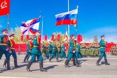 Samara, May 2018: Servicemen of the guard of honor carry the banner of Victory and the Russian tricolor at the ceremonial march of. Russia, Samara, May 2018 stock photo