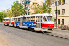 Samara public transport. Tram runs on the city street in summer. Samara, Russia - May 09, 2017: Samara public transport. Tram runs on the city street in summer Stock Image