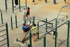 Samara, Russia - August 23, 2014: strangers on the Playground ex. Ercise in Samara, Russia - August 23, 2014 Stock Images