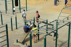Samara, Russia - August 23, 2014: strangers on the Playground ex Stock Photos