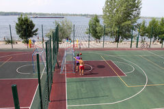 Samara, Russia - August 23, 2014: strangers on the Playground pl. Aying ball in Samara, Russia - August 23, 2014 Stock Photography