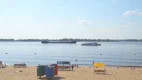 The tanker floats on the river. SAMARA, RUSSIA - CIRCA JUNE, 2018: The tanker floats on the river. Next floats passenger boat stock video