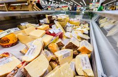 Tasty freshly cheese ready to sale in the showcase at the superm Royalty Free Stock Photos