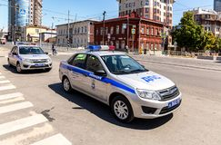 Russian police patrol car of the State Automobile Inspectorate parked up on the city street in. Samara, Russia - June 23, 2018: Russian police patrol car of the stock photography
