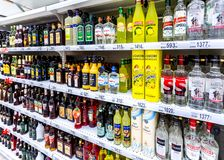 Various bottled alcoholic beverages ready for sale stock photography