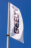 SAMARA, RUSSIA - MAY 25, 2014: The flag of Geely over blue sky. Royalty Free Stock Images