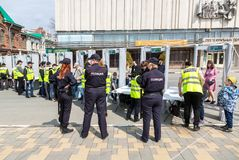 People pass through police frames metal detectors. Samara, Russia - May 1, 2018: People pass through police frames metal detectors at the city street in summer royalty free stock photography