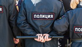 Russian policeman with police truncheon. Samara, Russia - May 5, 2018: Russian policeman with police truncheon. Text in russian: Police stock photo