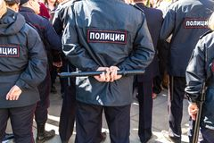 Russian policeman with police truncheon. Samara, Russia - May 5, 2018: Russian policeman with police truncheon. Text in russian: Police stock photos