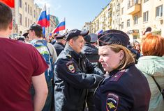 Russian policeman and policewoman during an opposition protest. Samara, Russia - May 5, 2018: Russian policeman and policewoman during an opposition protest royalty free stock images