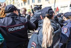 Russian policeman and policewoman during an opposition protest. Samara, Russia - May 5, 2018: Russian policeman and policewoman during an opposition protest stock images
