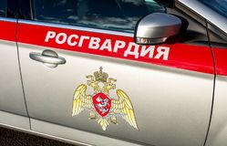 Inscription Rosgvardia and emblem of the troops of the National Guard of the Russian Federation on the board of car Stock Image