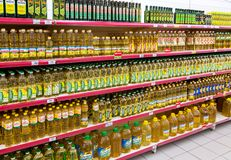 Different packaged sunflower oil ready for sale in the supermark Stock Photos