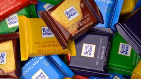 Samara, Russian Federation - August 13, 2018: Ritter sport chocolates mini rotate background. Ritter Sport - a popular. German brand of chocolate, which is sold stock video footage