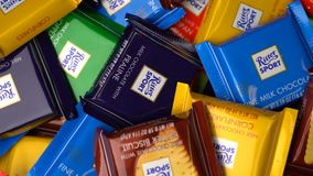 Samara, Russian Federation - August 13, 2018: Ritter sport chocolates mini rotate background. Ritter Sport - a popular. German brand of chocolate, which is sold stock video
