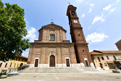 In  the samarate  old   church  closed  tower sidewalk italy  lo. In  the samarate old   church  closed brick tower sidewalk italy  lombardy Stock Photo