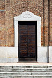 Samarate  varese italy the old door entrance and mosaic Stock Images