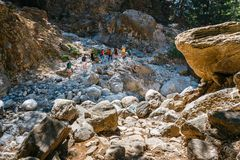 Tourists hike in Samaria Gorge in central Crete, Greece. The national park is a UNESCO Biosp Stock Photos