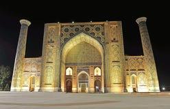Samarkand: night view of Registan madrasah stock images