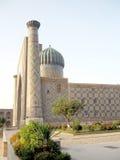 Samarkand Registan o Sher-Dor Madrasah no por do sol 2007 Imagens de Stock