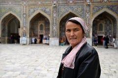 Samarkand, Uzbekistan, Silk Route. SAMARKAND, UZBEKISTAN - 22 APRIL 2019: The Uzbek tourist with the admiration is examining monuments of Samarkand on the Silk royalty free stock photo