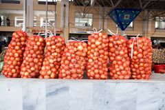 Huge net bags full with onions royalty free stock photo