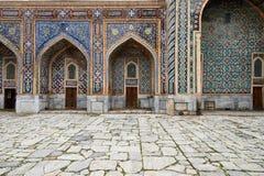 Example of architecture Samarkand, Uzbekistan, Silk Route. Samarkand, Uzbekistan, Registon main square admiring ancient monuments of Samarkand, of architectural stock photo