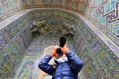 Samarkand, Uzbekistan, Silk Route. Samarkand, Uzbekistan, Tourist on the Registon main square admiring ancient monuments of Samarkand, of architectural pearl on royalty free stock image