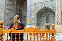 Samarkand, Uzbekistan, Silk Route. Samarkand, Uzbekistan, Tourist on the Registon main square admiring ancient monuments of Samarkand, of architectural pearl on royalty free stock images