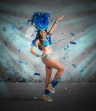 Samba dancer. Happy samba dancer with brilliant blue costume stock photo