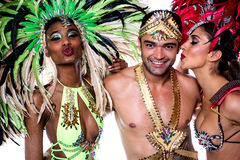 Samba dancers kissing over white. Samba dancers with colorful costume over white Royalty Free Stock Photo