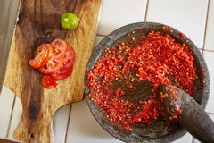 Sambal and its additional ingredient Royalty Free Stock Images